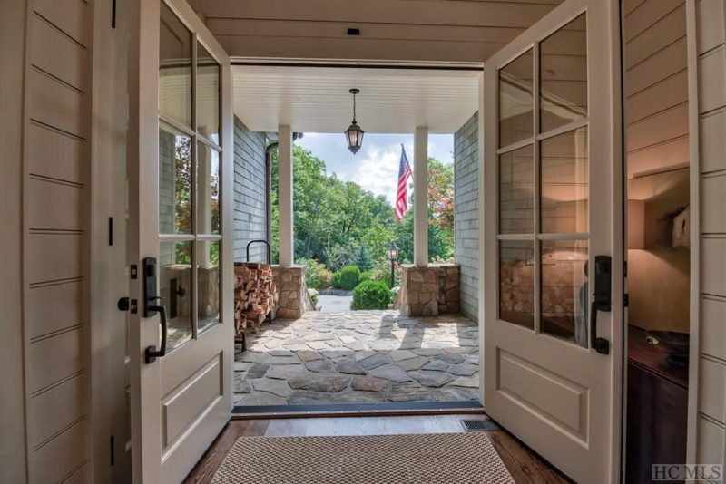 Open double doors leading to front porch