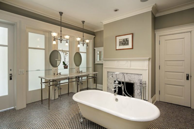Bathroom with freestanding tub and fireplace