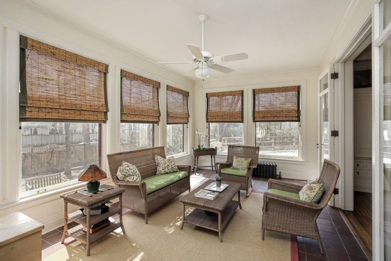 Sunroom with wicker furniture and bamboo shades