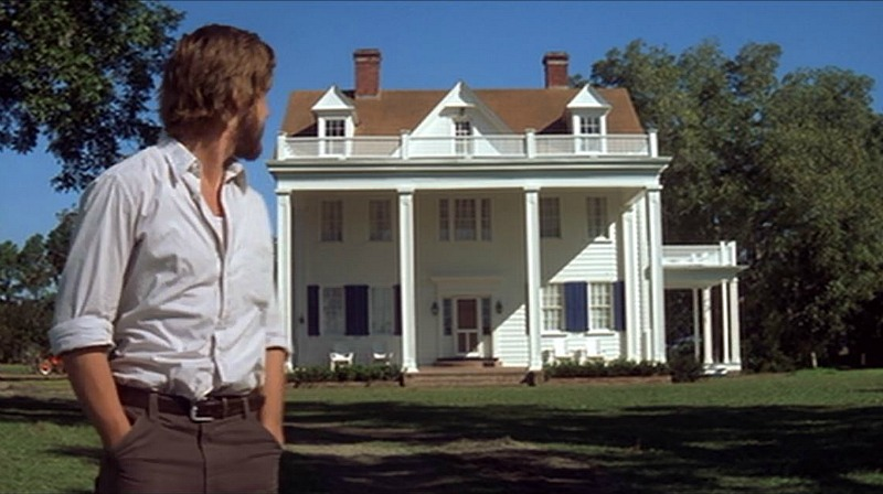 Noah in front of his finished house The Notebook