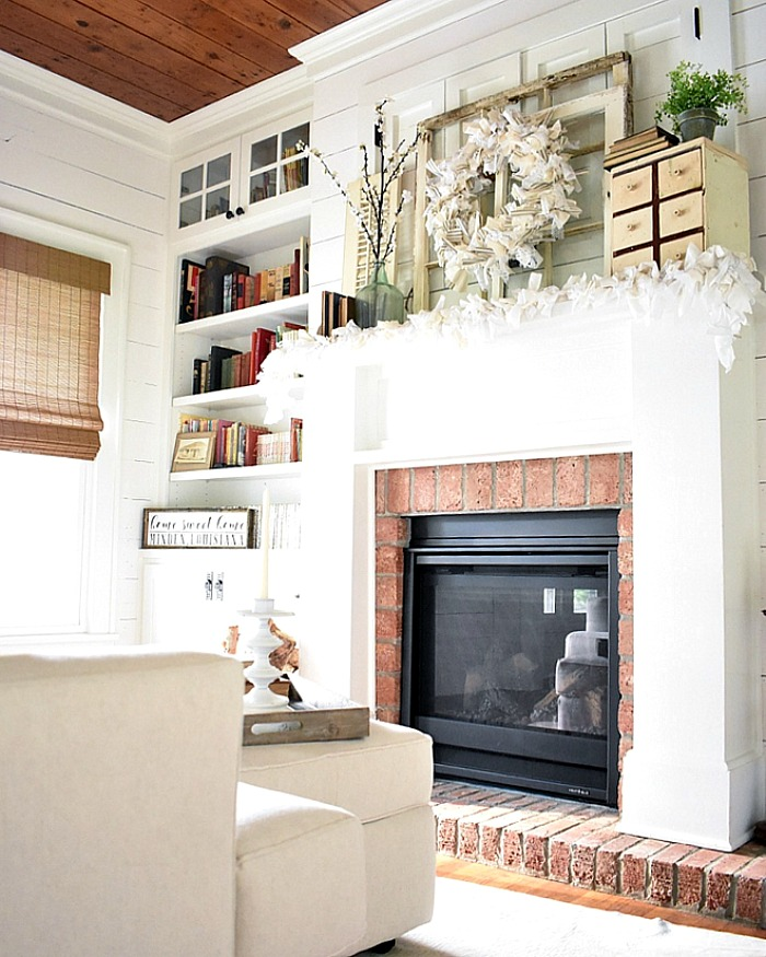 Cottage fireplace with shiplap walls