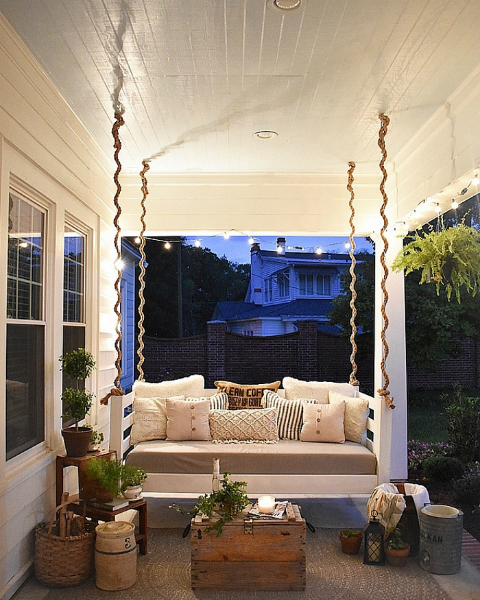 Cottage porch at night daybed swing