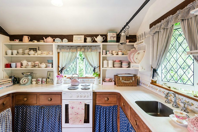 Small cottage kitchen with skirted lower cabinets