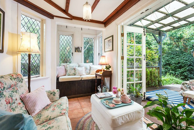 Room with window seat and leaded glass windows that opens to back deck