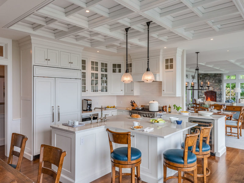 White kitchen with island in Cape Cod beach house