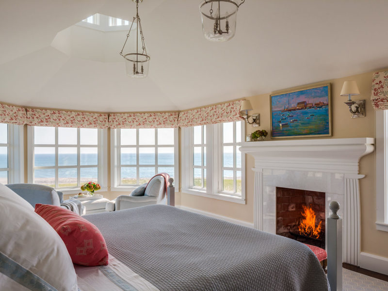 Beach house bedroom with fireplace overlooking the water