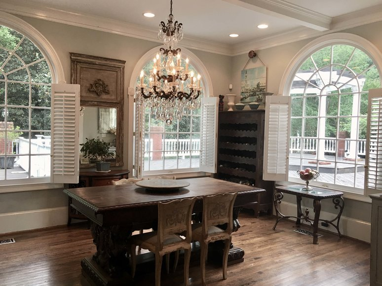 Dining room table and chairs with large chandelier