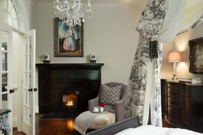 Black fireplace in bedroom