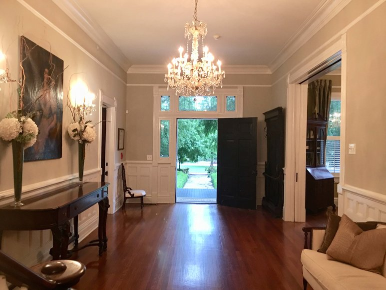 Front entry hall of mansion with chandelier