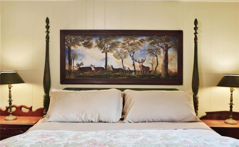 Artwork above headboard in bedroom