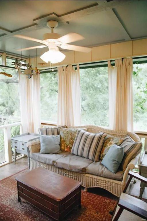 Screened porch with wicker sofa