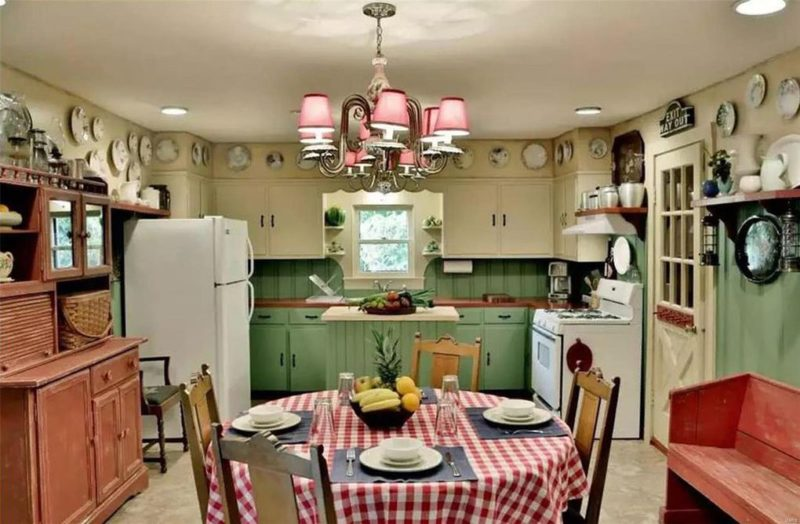 Cottage kitchen with green lowers and white upper cabinets, round table and chairs