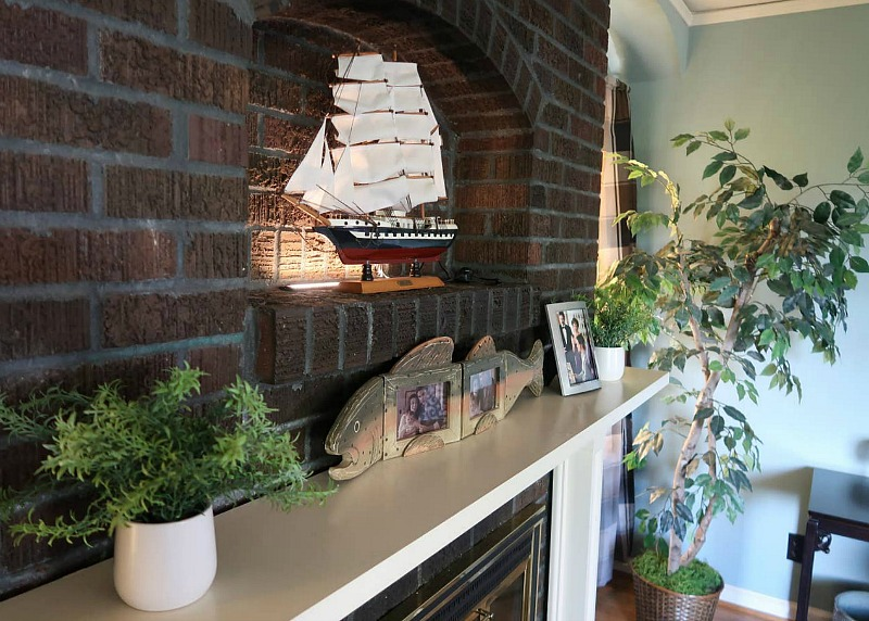 Closeup of fireplace mantel and model ship