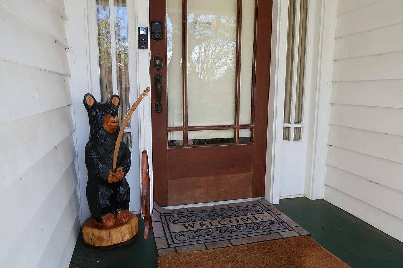 Front door with bear statue fishing