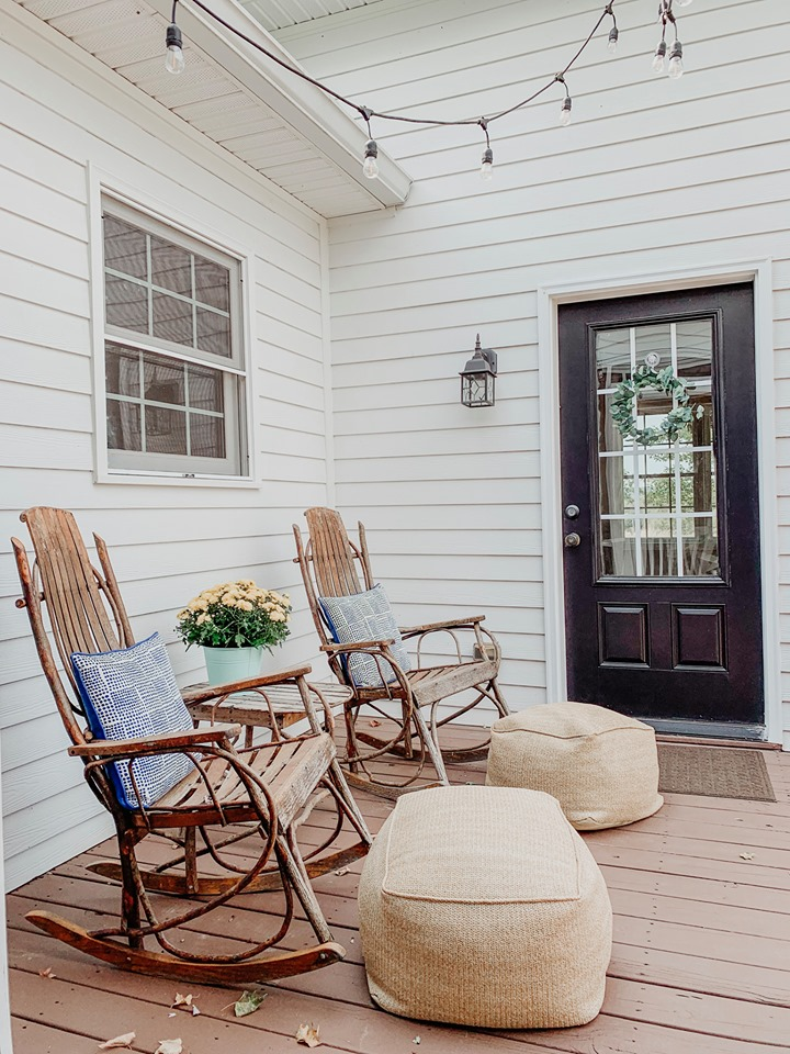 Two chairs on back deck of farmhouse