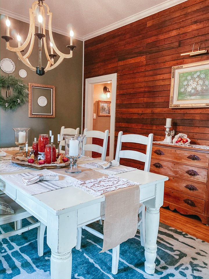 A dining room table with original shiplap walls
