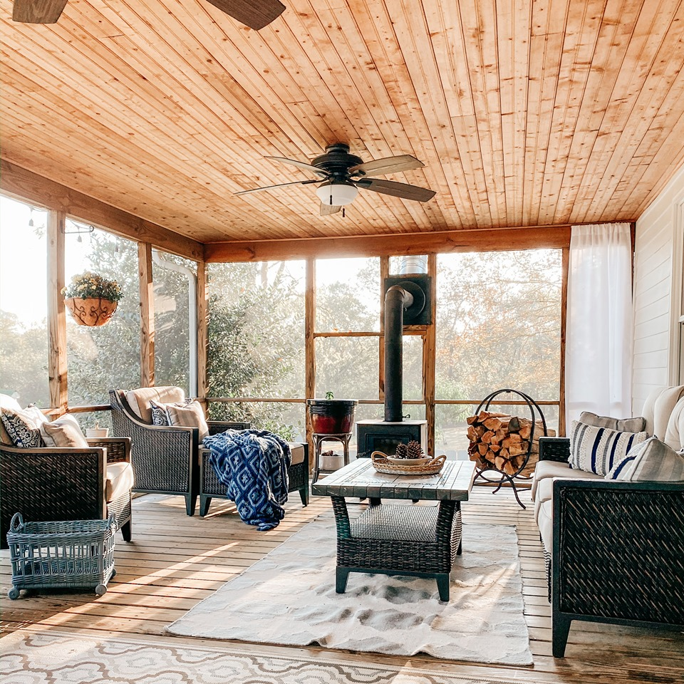 Screened porch with wood-burning stove and ceiling fan