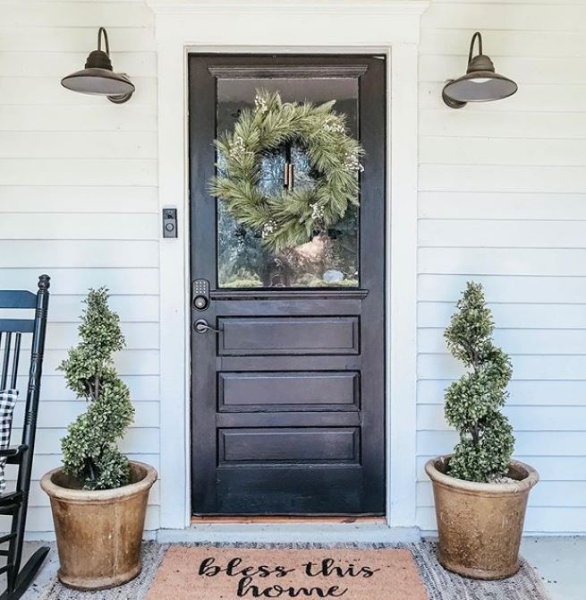 Black door with wreath