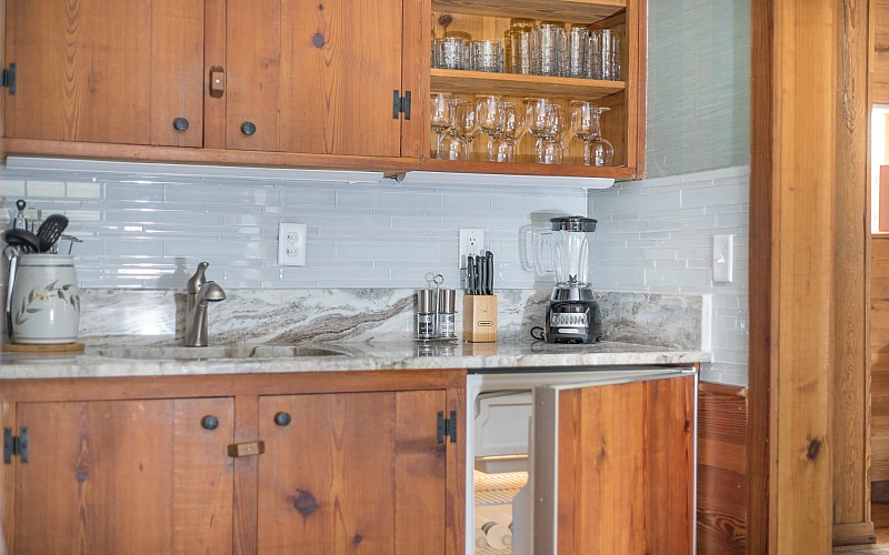 A kitchen with wood cabinets