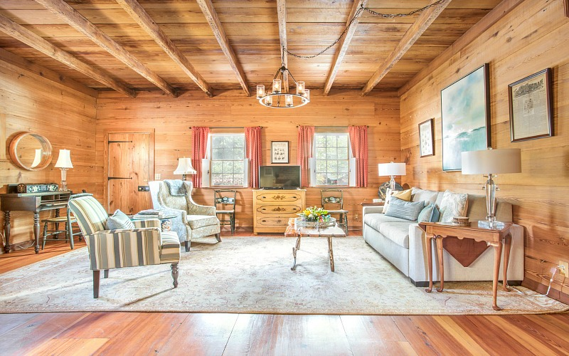 Freeman\'s Cottage living room with wood-plank walls
