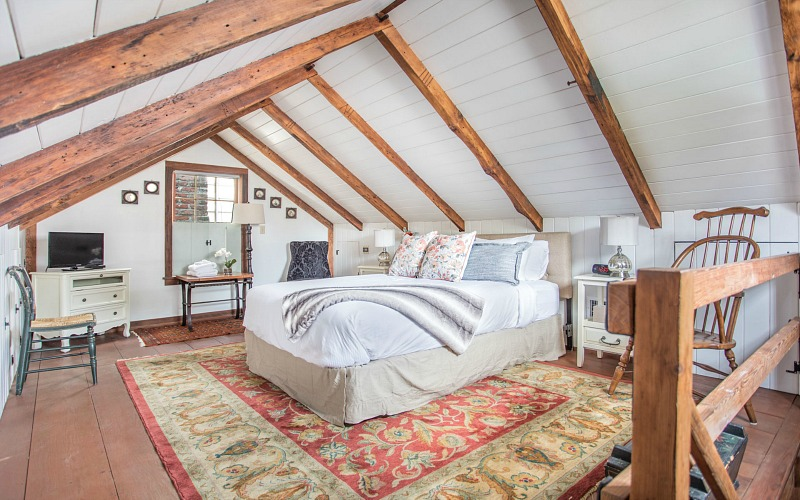 Upstairs cottage bedroom with vaulted beamed ceiling