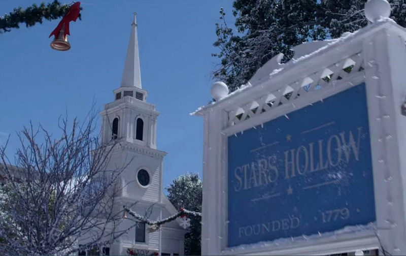 Stars Hollow town sign and church in snow