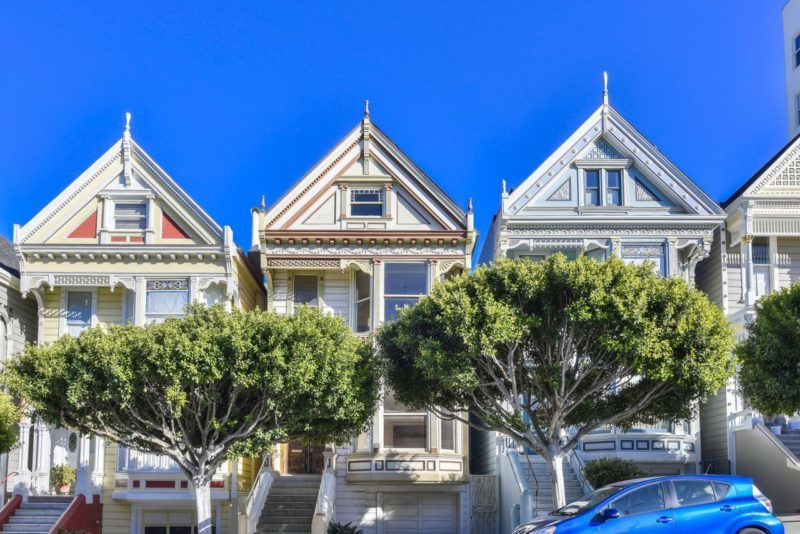 View of painted Victorians along 714 Steiner in San Francisco