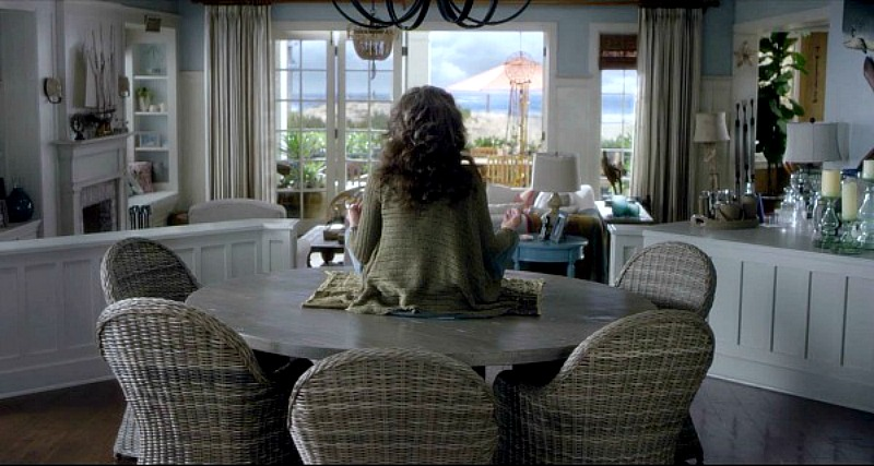 Dining Room Table and Wicker Club Chairs Grace and Frankie