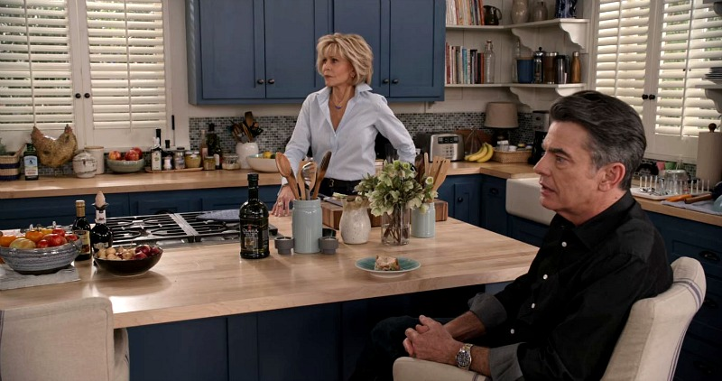 Grace and Frankie beach house kitchen blue cabinets