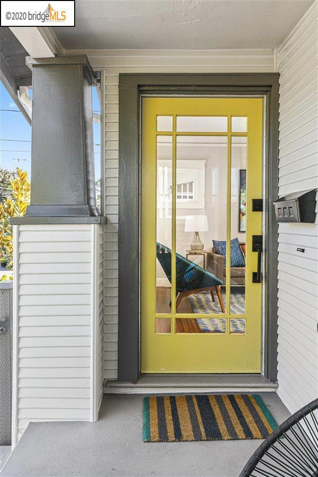 Yellow front door on Bungalow