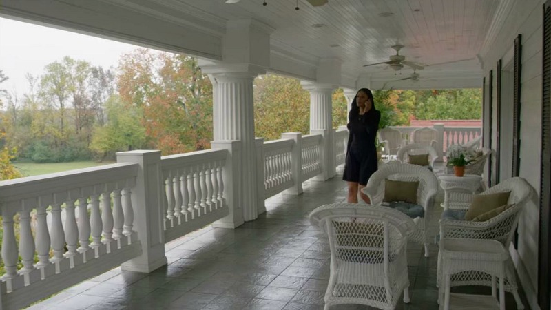 Grace Greenleaf on second story porch