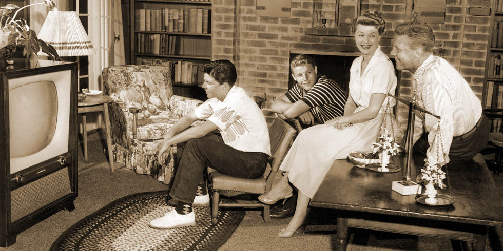 Ozzie and Harriet Nelson family in pub room of house