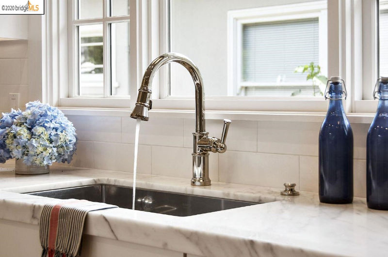 White kitchen chrome faucet