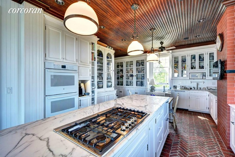 beach house kitchen brick floor