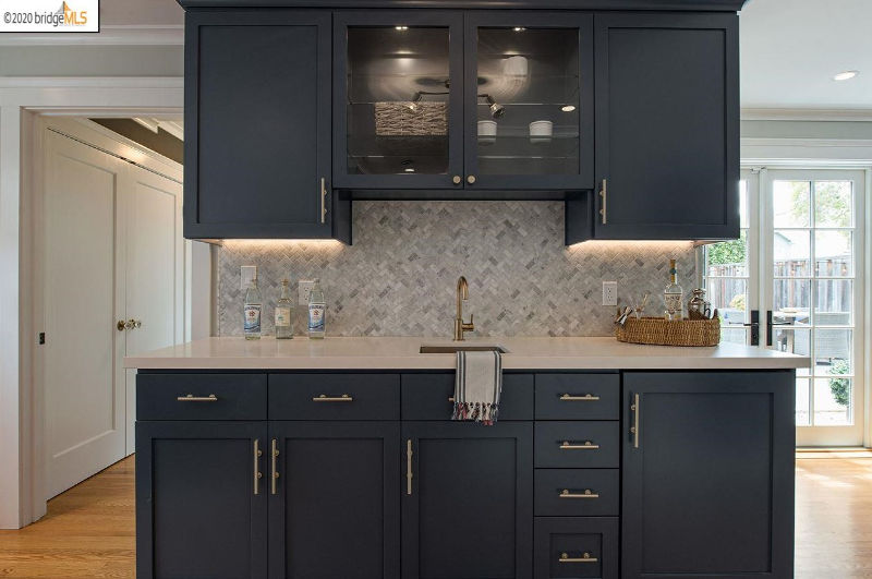 navy blue cabinets bar