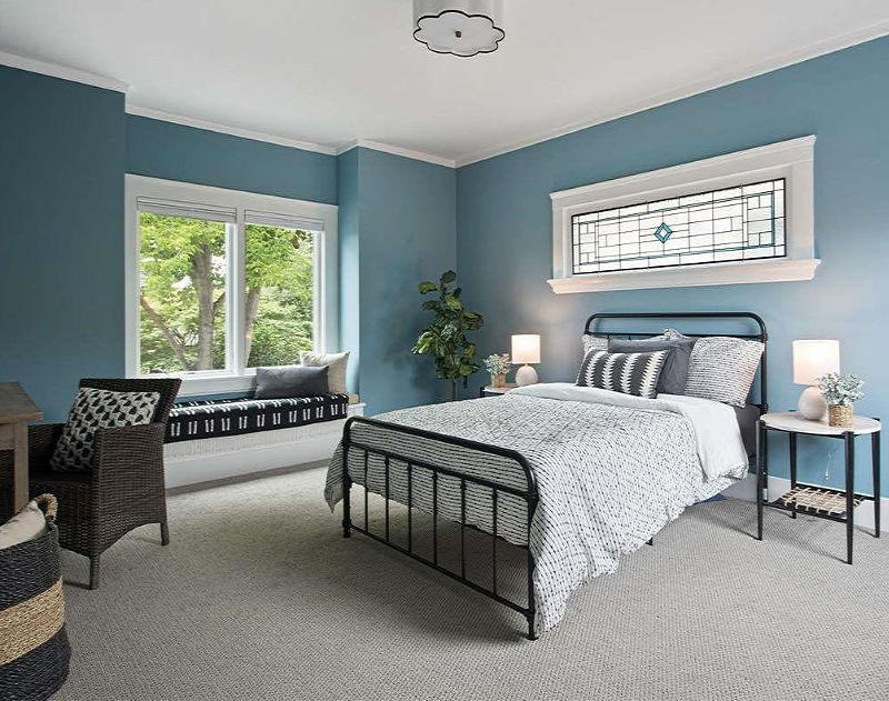 teal blue bedroom in Oakland house