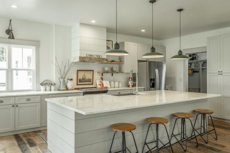 kitchen in modern farmhouse with marble island