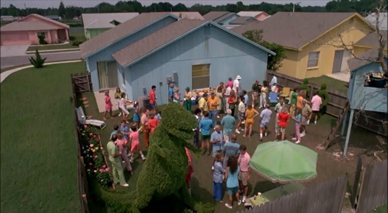 peg's house backyard dinosaur topiary