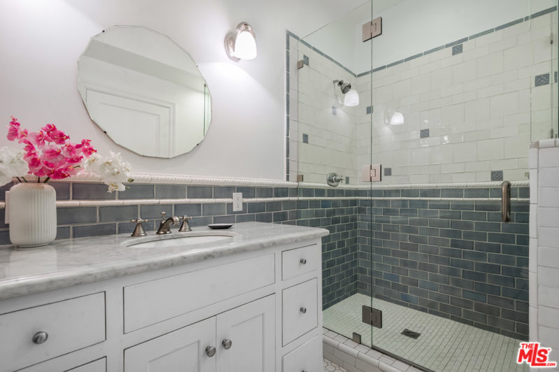 White bathroom with sink and shower