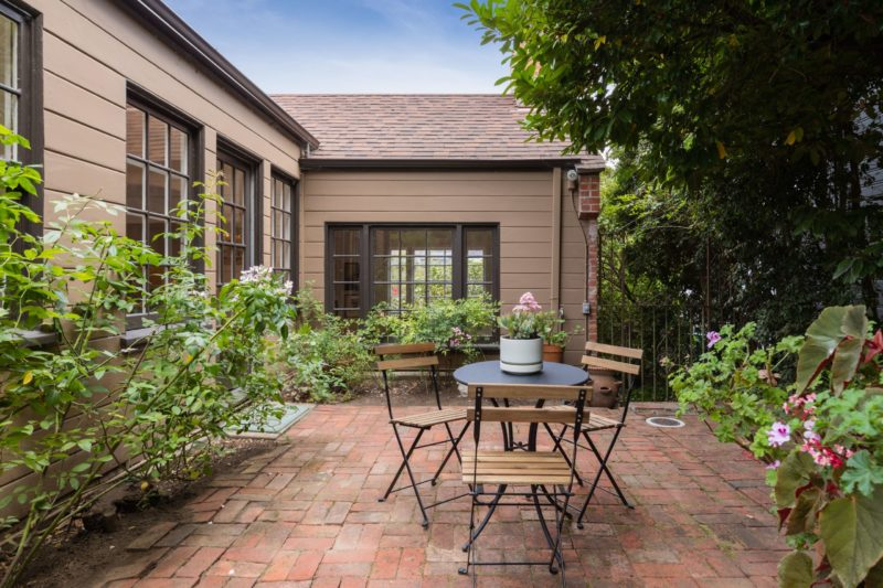 Back patio with brick pavers and table with chairs