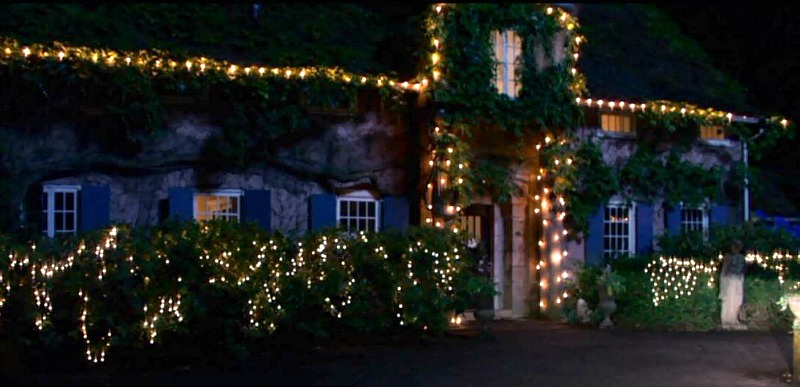 cottage decorated with Christmas lights