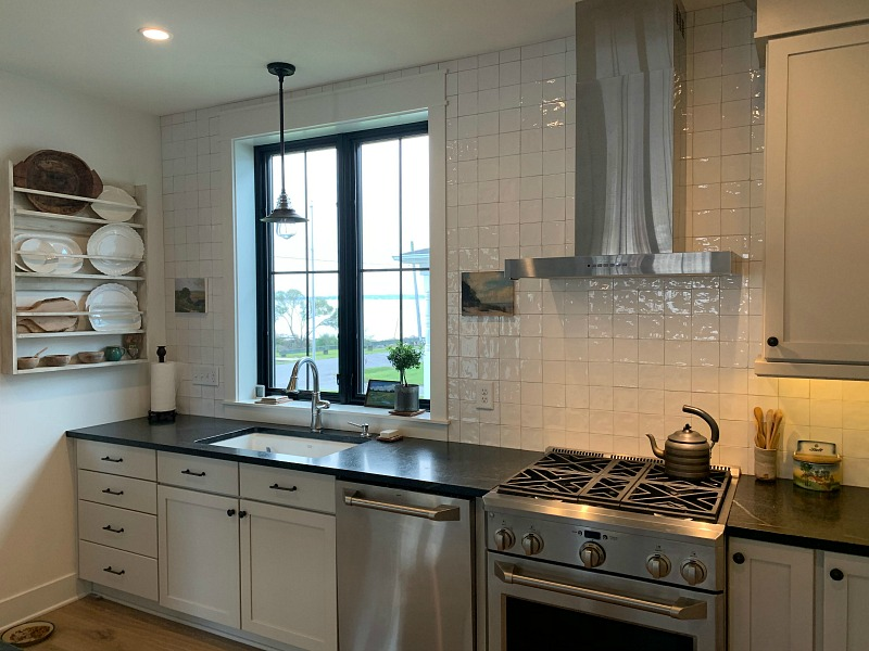 white kitchen black countertops black windows