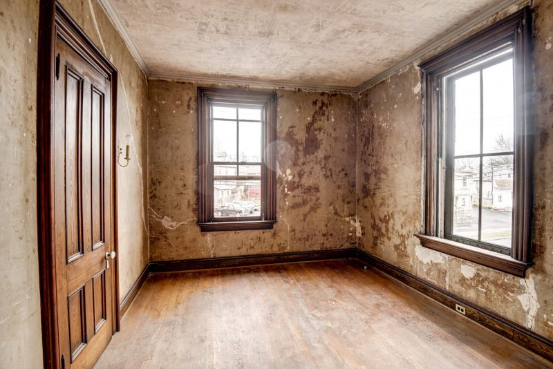 Unfurnished upstairs bedroom with windows