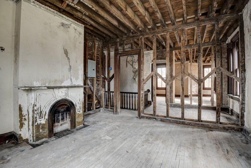 Original vintage fireplace in unfinished room
