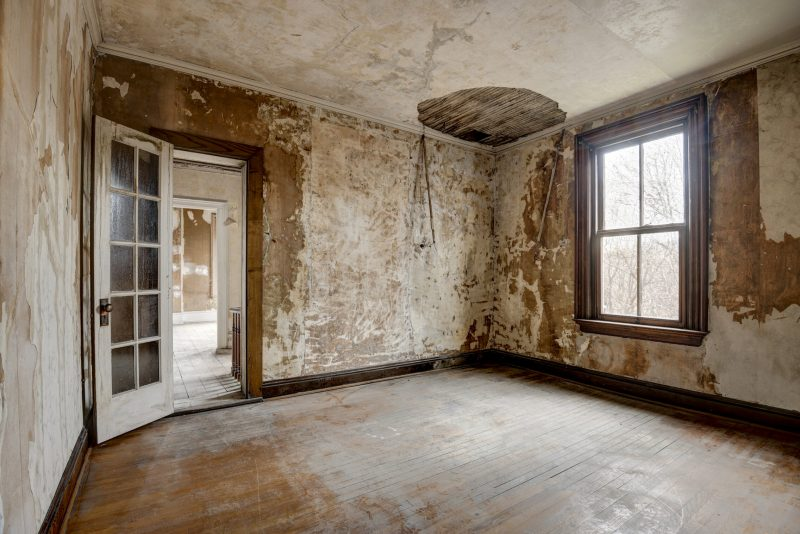 Unfurnished unfinished bedroom with missing plaster