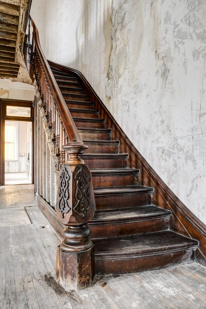 grand staircase inside haunted castle