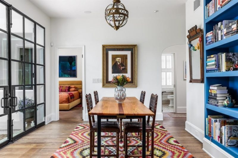 dining room with blue bookshelves