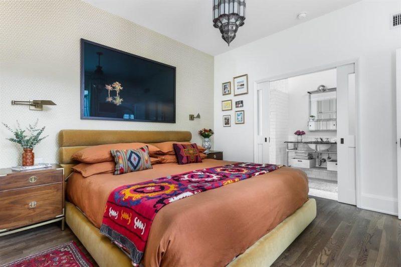 Bungalow bedroom with a bed and door to bathroom