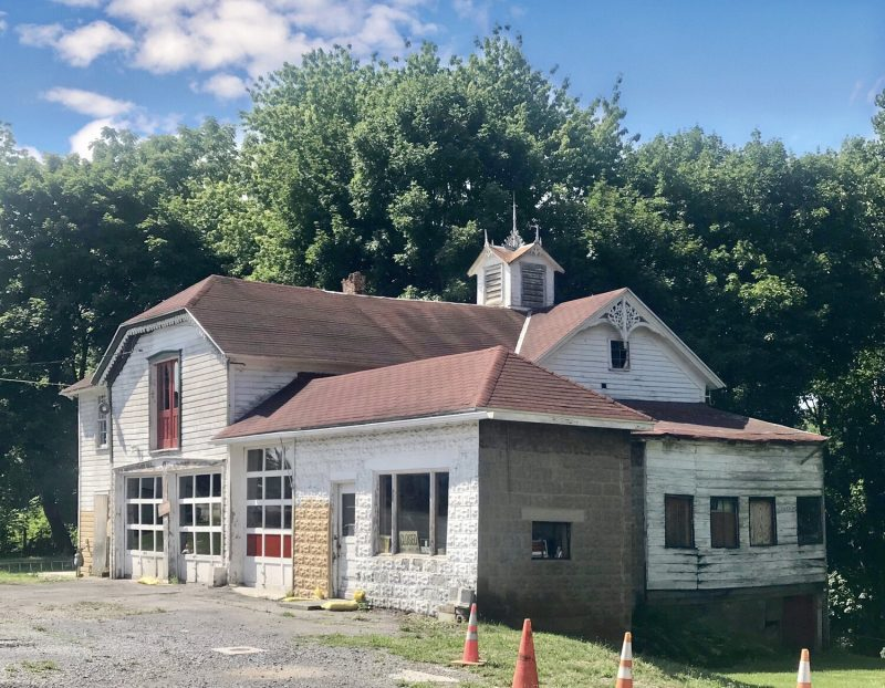 former gas station carriage house on property