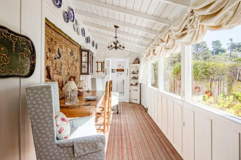 long room lined with windows in cottage